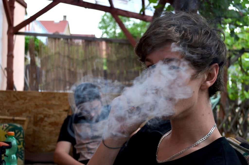 SMOKING WEED.